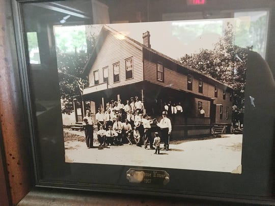 A photo in the restaurant shows The Grove House in 1917.