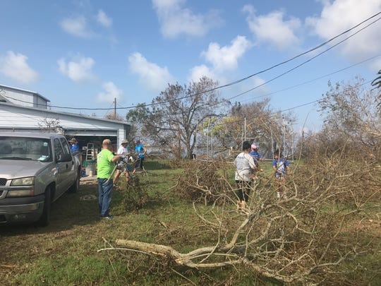 Ingleside coaches and athletes help with clean up after Hurricane Harvey.