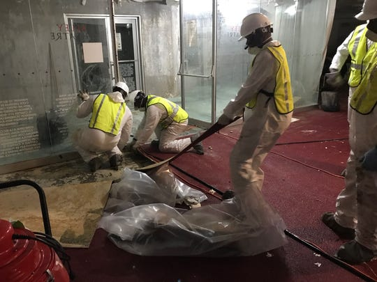 Workers begin cleaning up Alley Theater in Houston,