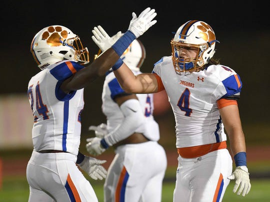 Madison Central's Kirkland Trahan (4) gets congratulations from Kenneth Ndebele (24) after sacking the Clinton quarterback on Friday, September 22, 2017, at Clinton High School in Clinton, Miss.