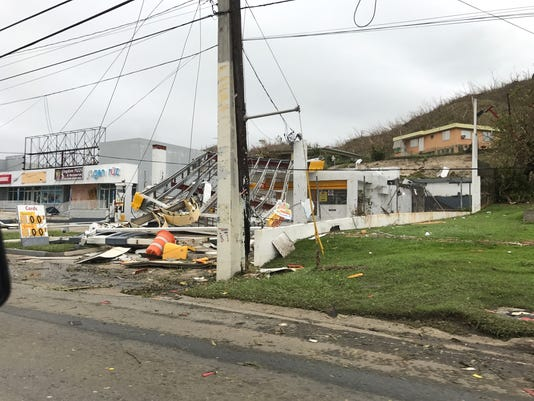 A gas station appears destroyed in Puerto Rico