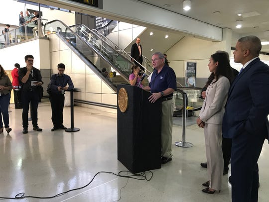 U.S. Sen. Bob Menendez speaking with reporters at Newark
