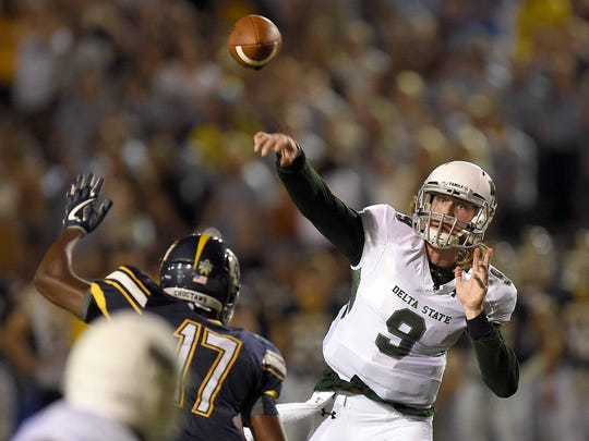 Delta State quarterback Breck Ruddick (9) throws over the Mississippi College pass rush on Saturday, September 30, 2017, at Mississippi College in Clinton, Miss.
