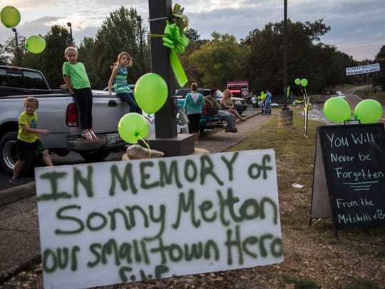 Wearing green, friends and family gather at Big Sandy