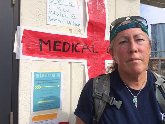 Jen Nadeau, a retired firefighter-EMT from Vallejo Fire is shown at a shelter in Petaluma on Tuesday. Nadeau has been volunteering at the shelter for fire evacuees in Petaluma every day since the fires broke out, helping people cope with anxiety and assessing their health needs.