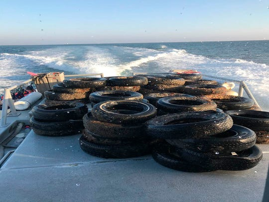 This Oct. 12 photo provided by the California Coastal Commission and UC Davis shows a pile of scrap tires after they were pulled out of the water off Balboa Peninsula in Newport Beach.