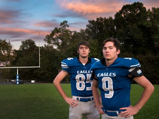 Jackson Christian football players and fraternal twins Zach Simpson and Nick Simpson pose for a portrait Tuesday, October 17, 2017, after practice at Jackson Christian High School.