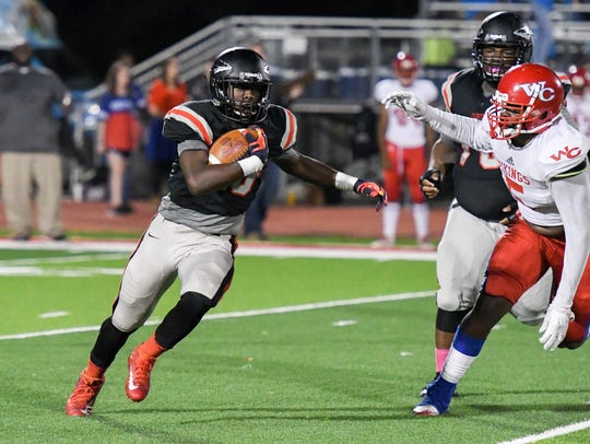 Clinton's Marcus Henderson tries to get outside during