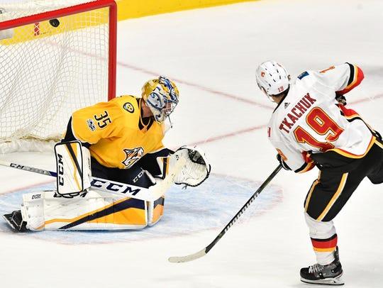 Calgary Flames left wing Matthew Tkachuk (19) scores