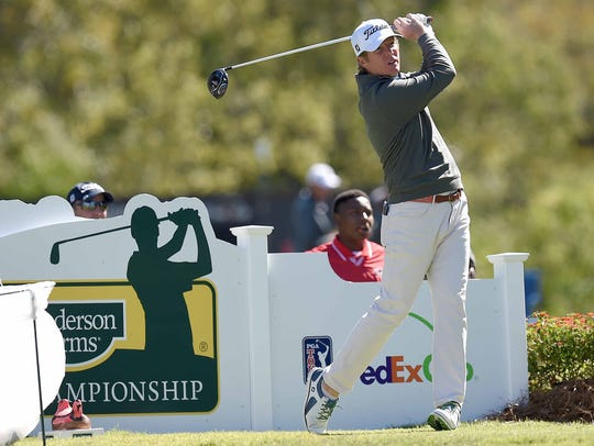 Derek Fathauer tees off on the 18th hole on Wednesday,
