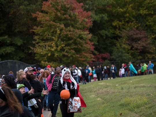 Costumed attendees of the 10th annual Jackson-Madison County Trunk or Treat line up Oct. 28, 2017, at the Ballpark at Jackson.