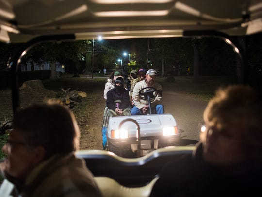 "Ghost tour attendees ride ""limo golf carts"" through the streets of Bolivar on Saturday, Oct. 28, 2017, during Epic Haunted Tours' ""History, Legends & Maybe Some Ghosts Tour"" in Bolivar."