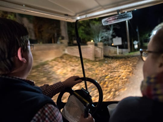 """Tour guide Brandon Burvee, of Bolivar, drives guests through the streets of Bolivar on """"limo golf carts"""" on Saturday, Oct. 28, 2017, during Epic Haunted Tours' """"History, Legends & Maybe Some Ghosts Tour."""""""