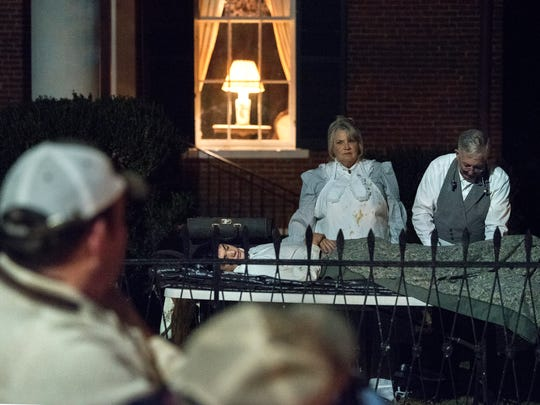 """George and Patricia Spencer act as the late Dr. and Mrs. Coleman while Josh Allen plays a wounded soldier Saturday, Oct. 28, 2017, during Epic Haunted Tours' """"History, Legends & Maybe Some Ghosts Tour"""" in Bolivar."""