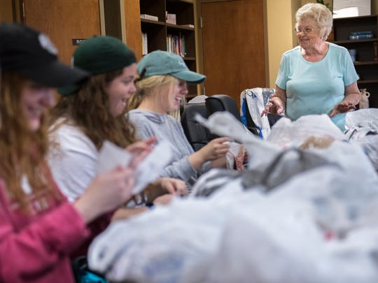June Ksiezak, of Jackson, tells stories to Union University students as they prepare materials for crocheting plastic-bag sleeping mats Tuesday, Nov. 7, 2017, at Concordia Lutheran Church in Jackson. Union University students participated in their annual Campus and Community Day with service projects helping area churches, non-profits, schools and neighborhoods.
