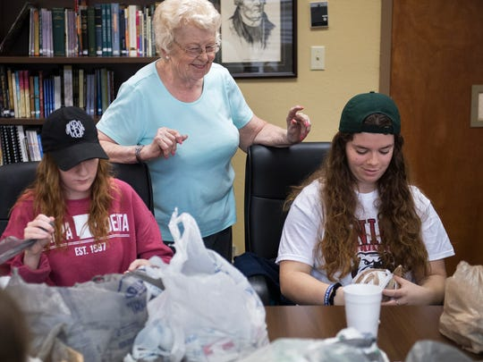 June Ksiezak, of Jackson, chats to Union University students Tuesday, Nov. 7, 2017, as they help prepare materials for crocheting plastic-bag sleeping mats at Concordia Lutheran Church in Jackson. Union University students participated in their annual Campus and Community Day with service projects helping area churches, non-profits, schools and neighborhoods.