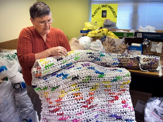 Nina Clement shows a rainbow plastic-bag sleeping mat she created Tuesday, Nov. 7, 2017, at Concordia Lutheran Church in Jackson.