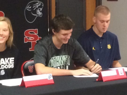 Drew Blair signs his letter to play basketball at Northwest Missouri State.