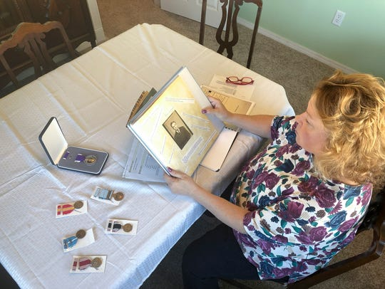 Bernadette Largent looks at a picture of her father