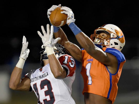Madison Central's Cameron White (1) intercepts the pass intended for South Panola's John Railey (13) during a MHSAA Class 6A first round playoff game on Friday, November 10, 2017, at Madison Central High School in Madison, Miss.