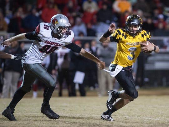 Adamsville's Mason McCann attempts to grab Trenton