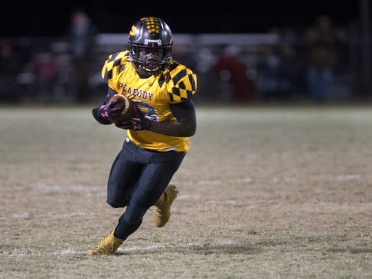 Trenton Peabody's Khance Hill runs with the ball Friday, Nov. 9, 2017, during Trenton Peabody's 14-7 victory over Adamsville at the Walter Kilzer Stadium in Trenton.