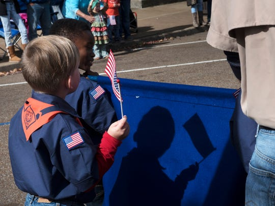 Boy Scouts walk in the annual Veteran's Day parade