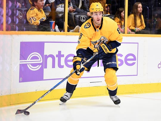 Predators center Kyle Turris looks to pass in a November game against the Washington Capitals.