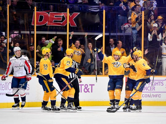 Nashville Predators left wing Kevin Fiala (22, right of center) reacts to scoring against the Washington Capitals during the second period at Bridgestone Arena in Nashville, Tenn., Tuesday, Nov. 14, 2017.