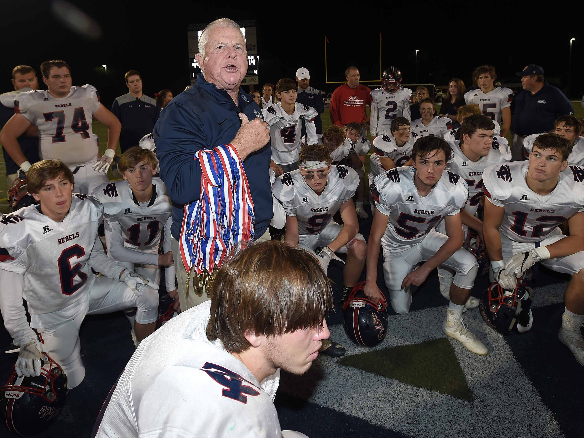 Les Triplett with the Mississippi Association of Independent Schools prepares to lead the teams in the Fellowship of Christian Athletes prayer after the game on Thursday, November 16, 2017, in the MAIS State Football Championships at Jackson Academy in Jackson, Miss.