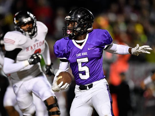 Cane Ridge's Devon Starling (5) advances against Ravenwood during the first half of the 6A quarterfinal game at Cane Ridge High School in Antioch, Tenn., Friday, Nov. 17, 2017.