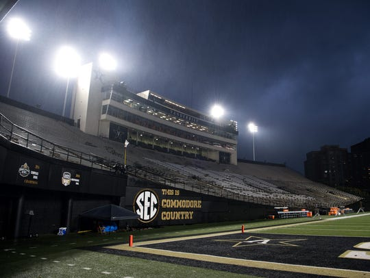 Storm clouds pass over Vanderbilt Stadium as rain falls before a game against Missouri on Nov. 18, 2017.