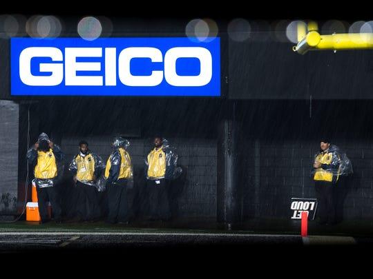 Security take cover as rain falls before a game between Vanderbilt and Missouri at Vanderbilt Stadium in Nashville, Tenn., Saturday, Nov. 18, 2017.