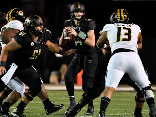 Vanderbilt quarterback Kyle Shurmur (14) looks for an opening against Missouri during the second half at Vanderbilt Stadium in Nashville, Tenn., Saturday, Nov. 18, 2017.