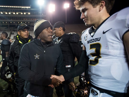 Vanderbilt head coach Derek Mason congratulates Missouri quarterback Drew Lock (3) after Vanderbilt's 45-17 loss at Vanderbilt Stadium in Nashville, Tenn., Saturday, Nov. 18, 2017.