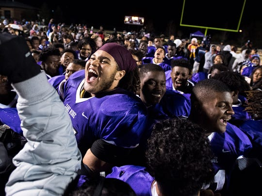 Cane Ridge's Hunter Dukes (77) reacts after their Class 6A semifinal victory over Whitehaven at Cane Ridge High School in Antioch, Tenn., Friday, Nov. 24, 2017.
