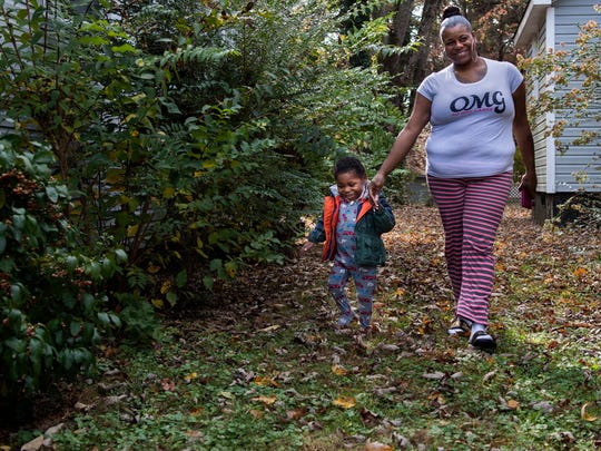 Chalisa DeGraffreed guides her 6-year-old son, Jarvis
