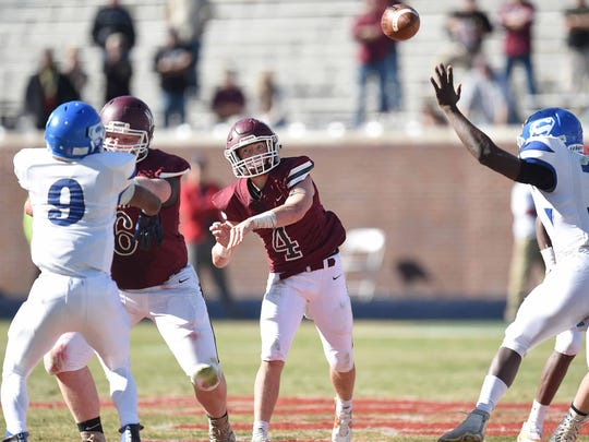 Nanih Waiya quarterback Cory Stanton (4) throws over the Simmons pass rush on Friday in the 1A state championship game in Oxford.