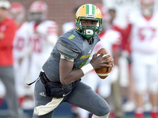 Taylorsville quarterback Tyvorius Keyes (8) rolls out of the pocket on Friday, December 1, 2017, at the MHSAA Football State Championships at Vaught-Hemmingway Stadium on the University of Mississippi campus in Oxford, Miss.