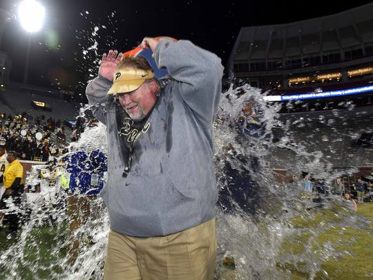 Pearl head coach John Perry gets the third of his water