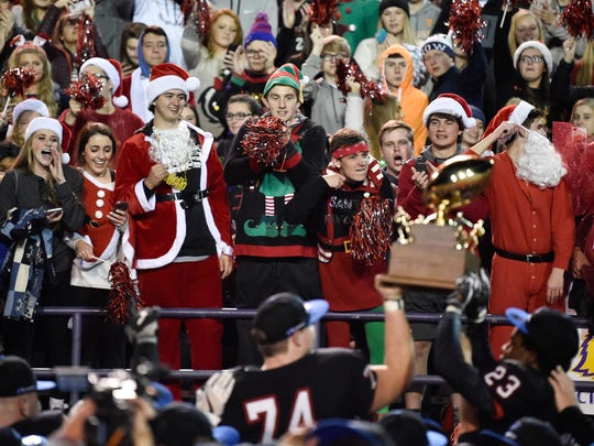 Maryville fans cheer as Maryville players hold up their