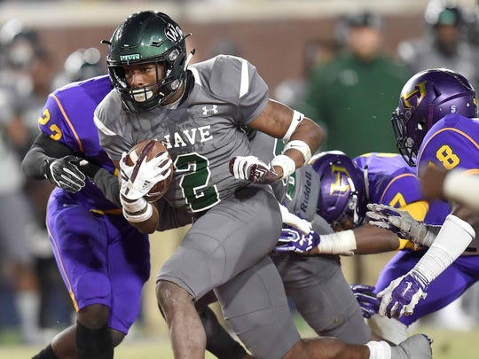 West Point's Marcus Murphy (2) breaks through the Hattiesburg line on his way to a touchdown on Saturday, December 2, 2017, at the MHSAA Football State Championships at Vaught-Hemmingway Stadium.
