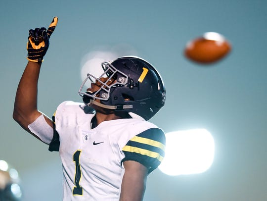 Lausanne's Eric Gray (1) celebrates his touchdown against
