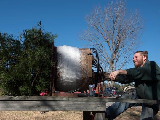 Sam Ward compresses a tree into a transportable size