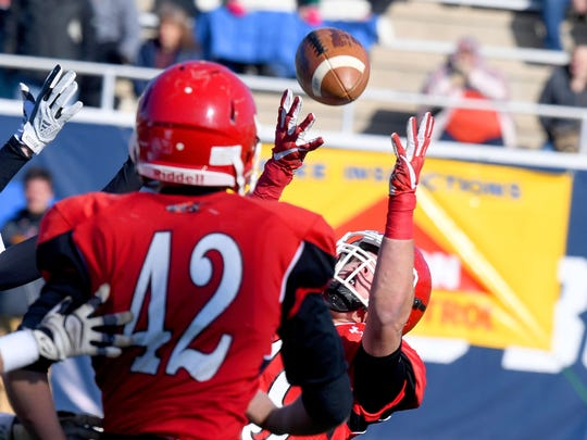 Riverheads' Forrest Shuey tries to catch the ball as teammate Moose Lee looks on during their final Class 1 state football championship game against Chilhowie in Salem on Sunday, Dec. 10, 2017.