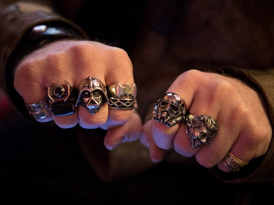 JJ Brent of Millersville, Tenn., shows his Star Wars rings while waiting in line for Star Wars: The Last Jedi at the Regal Opry Mills Stadium 20 in Nashville, Tenn., Thursday, Dec. 14, 2017.
