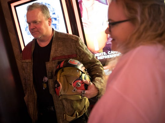 JJ Brent of Millersville, Tenn., is dressed as the character Poe Dameron while waiting in line for Star Wars: The Last Jedi at the Regal Opry Mills Stadium 20 in Nashville, Tenn., Thursday, Dec. 14, 2017.