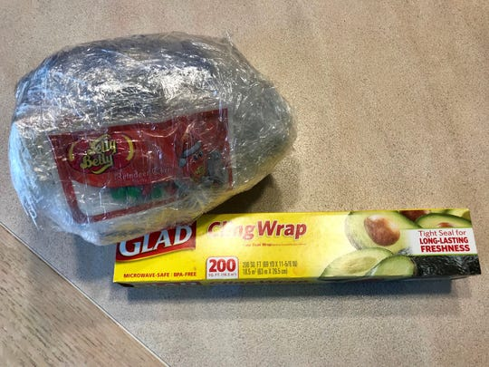 By wrapping a series of inexpensive gifts in layers
