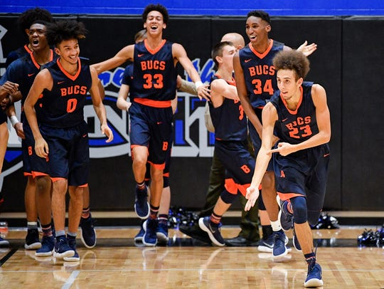 Beech's Jayson Brown (23) reacts to scoring the game-winning