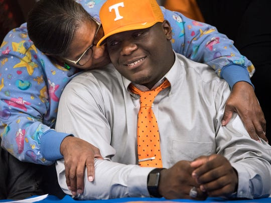 """North Side's Greg Emerson smiles as he is congratulated by his aunt, Loretta Emerson, on Wednesday, Dec. 20, 2017, during his signing day ceremony at North Side High School. """"I'm just so happy to be here for [Greg] on behalf of his dad, who passed away,"""" Loretta said. """"I'm just elated. I'm so proud of him."""""""
